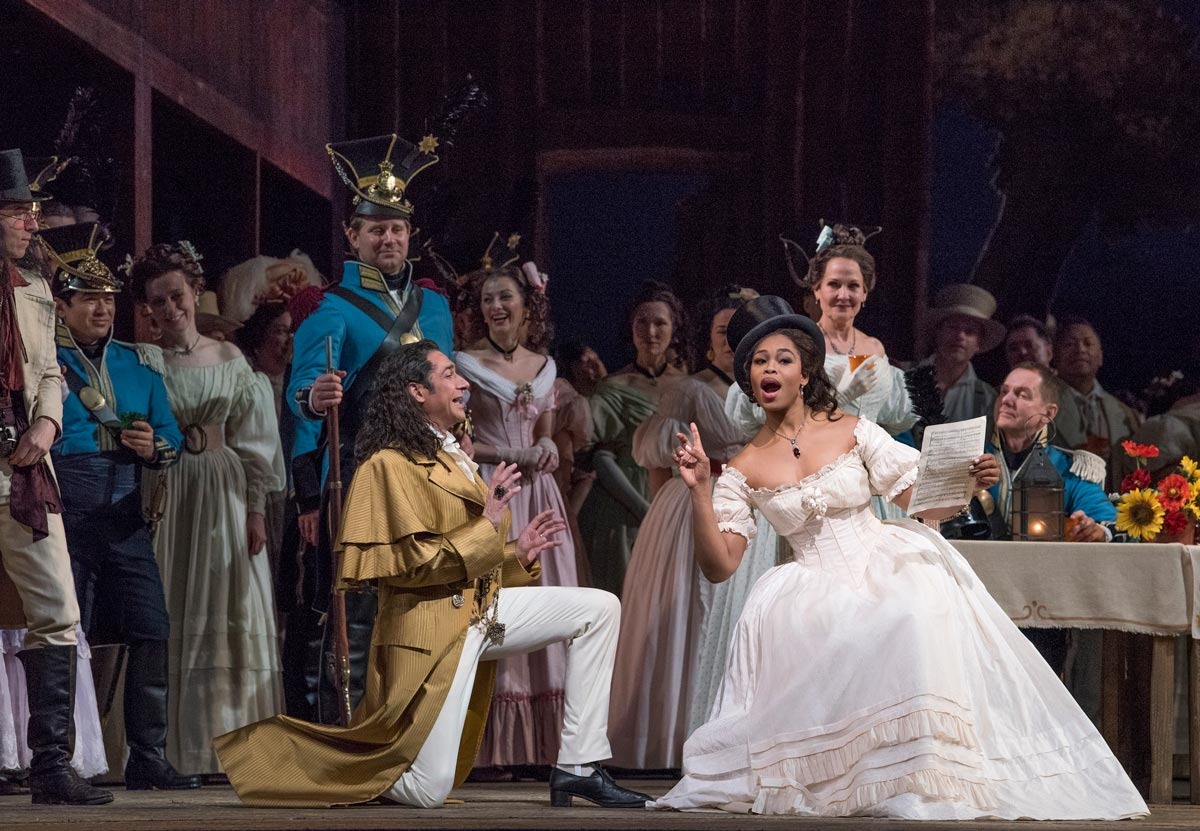 Ildebrando D'Arcangelo as Dulcamara and Pretty Yende as Adina in Donizetti's L'Elisir d'Amore