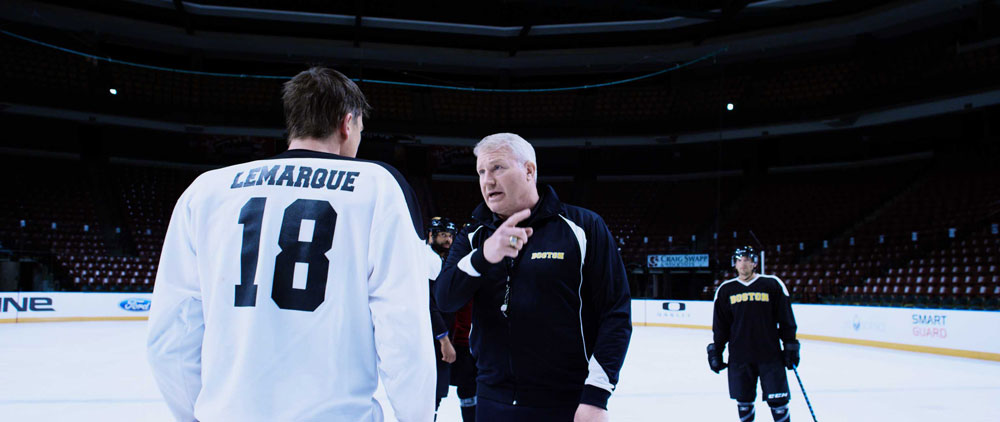 "(L-R) Josh Hartnett as Eric LeMarque and Marty McSorely as Boston Bruins Coach in the action/inspirational film ""6 BELOW"" a Momentum Pictures release. Photo courtesy of Momentum Pictures."