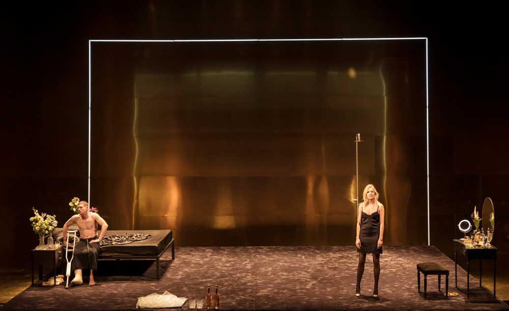 Jack O'Connell (Brick) and Sienna Miller (Maggie) in Cat on a Hot Tin Roof.