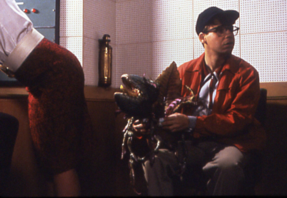 Audrey II (Levi Stubbs) and Seymour (Rick Moranis) in Little Shop of Horrors