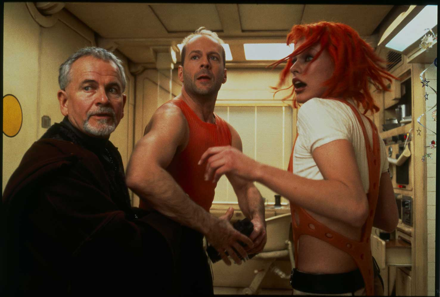 Ian Holm, Bruce Willis and Milla Jovovich in The Fifth Element (1997)