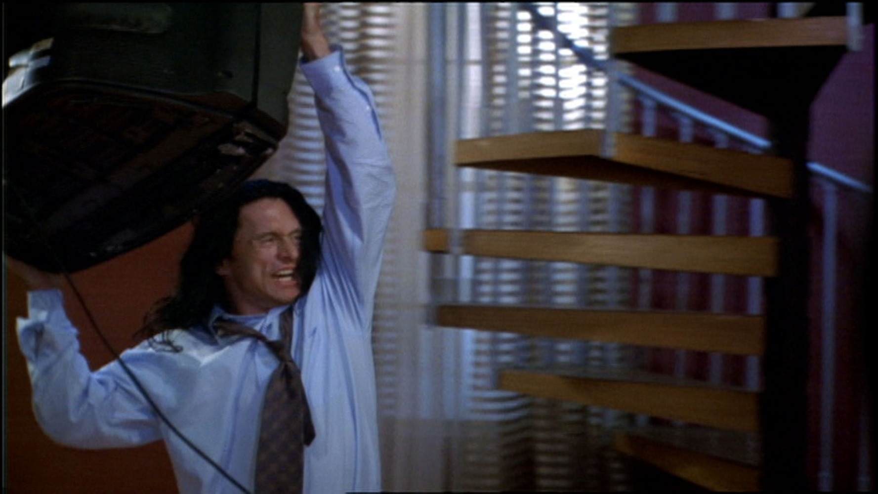A scene from Tommy Wiseau's The Room