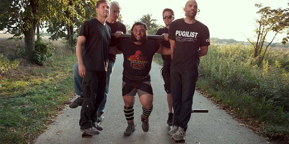 Patrik Baboumian (world record holding strongman) lifts film crew
